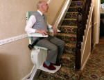 Smart gentleman on reconditioned straight stairlift in Gloucestershire