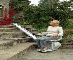 Lady on outdoor stairlift in Cardiff