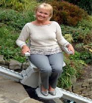 Lady traveling on a stairlift in her garden